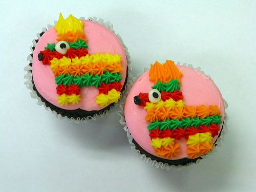 Pinata Cupcakes, just made with piped icing.