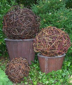 Art and Sculpture for your home, garden and landscape, using willow, hazel and other greenwoods. Willow balls or spheres in pots and tubs for wedding church and reception decorations. Willow spheres for entrance porches. Willow contemporary Christmas tree