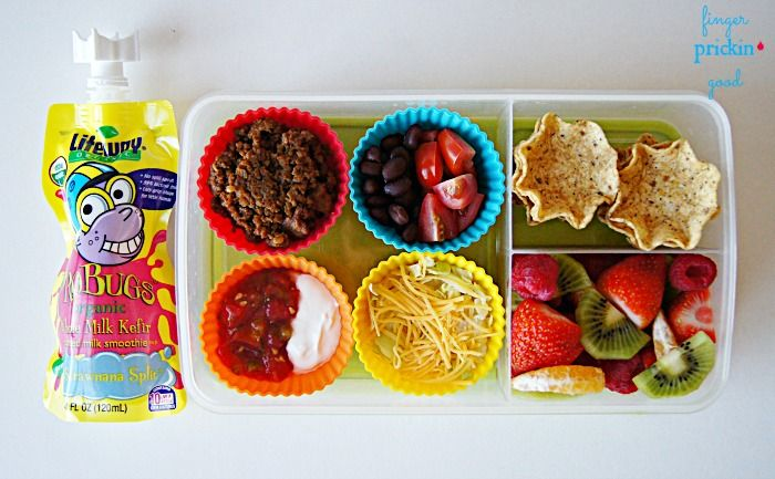 Here's what's inside: Build Your Own Taco Cups (tortilla scoops, taco meat, black beans, grape tomatoes, shredded lettuce, shredded cheddar cheese, salsa & sour cream)= 20 carbs Fresh Fruit (strawberries, raspberries, clementine slices & kiwi)= 16 carbs Lifeway Organic ProBug= 10 carbs Lunch Total= 46 carbohydrates