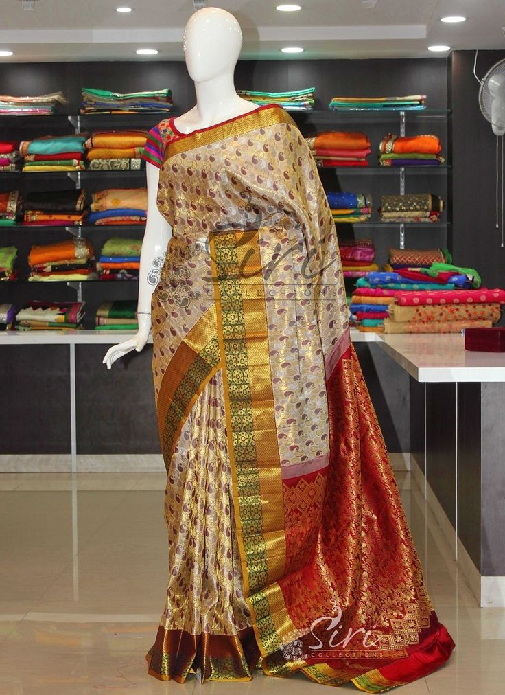 Gold Offwhite Authentic Pure Kanchipuram Silk Saree in paisley buti and heavy pallu.   It comes with an unstitched blouse fabric same as the pallu's colour.   ...
