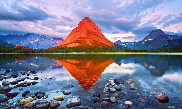 Montana Mt. Grinell natural phenomena: Photographer's stunning sunrise image transforms grey mountain peak into glowing orange beacon