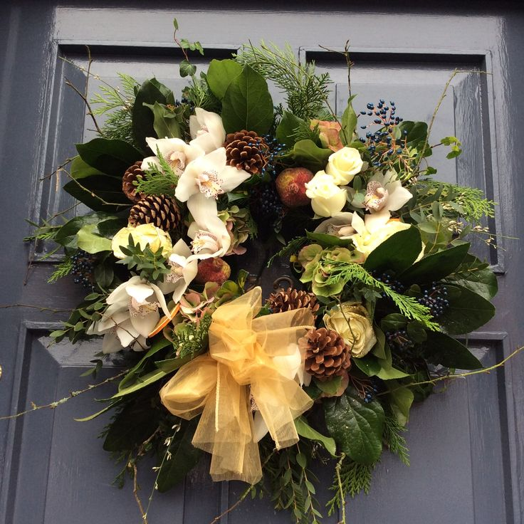 Fresh Christmas door wreath in creams, greens and whites hand made using orchids, hydrangea,pine cones, roses and foliages