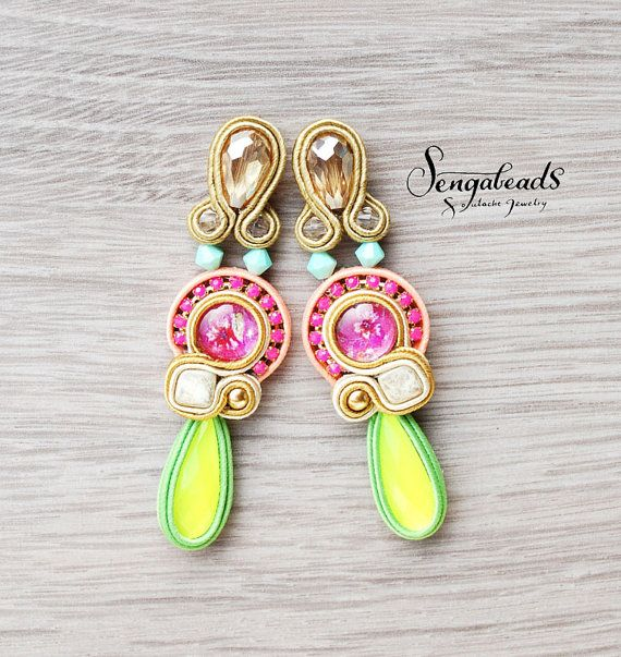 Soutache stud earrings with flower patterned glass cabochons in the middle…