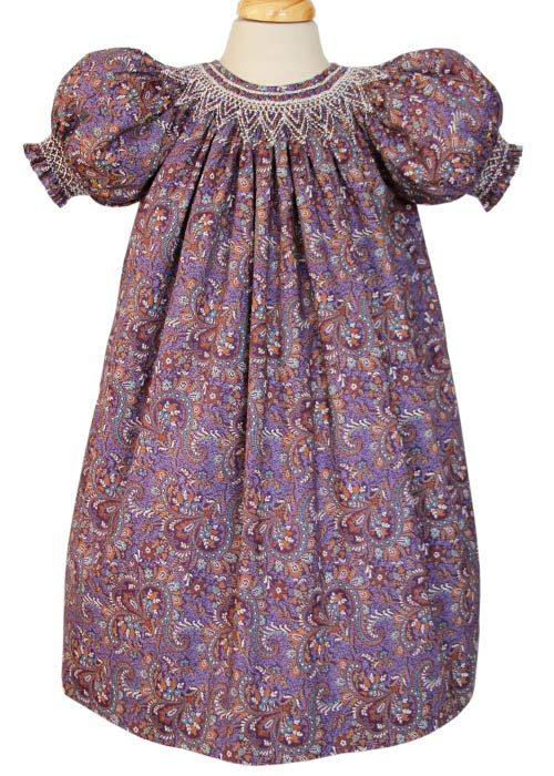 Girls hand smocked purple paisley fall dress, made in 100% cotton. The smocking around the neck line is done in cream color, absolutely divine.
