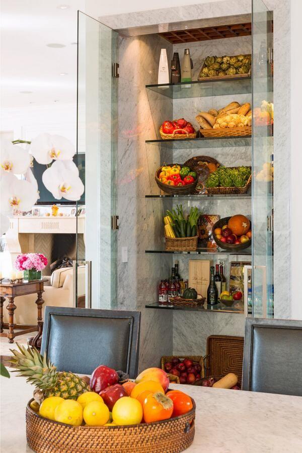 Yolanda Foster kitchen refrigerator fruit basket dark wood stools marble countertops