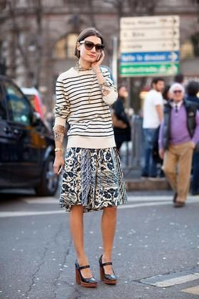 Great eclectic style.  We love mis-matched patterns!