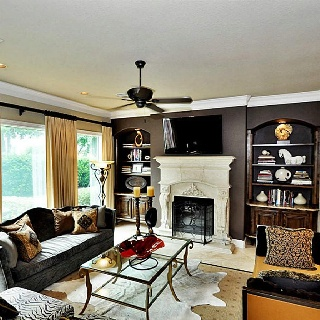 Pretty fireplace, like the dark brown accent wall