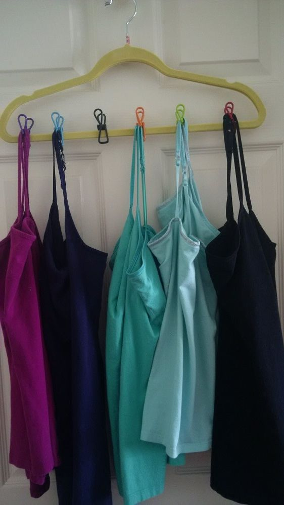 DIY cami rack made with Dollar Tree finds: 2 velvet covered hangers + 1 pack of multi-purpose clips. Using 2 hangers together are a perfect fit for the clips to keep them secure under the weight of the camis.