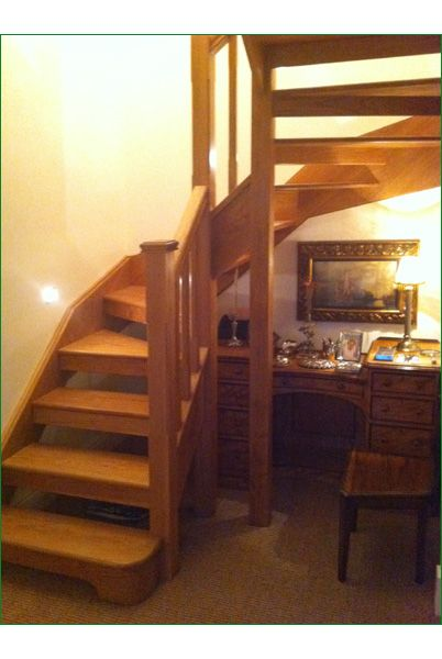 Clocktower Staircase - This staircase was designed to fit into a small area, utilising as much space as possible. American white oak was chosen to match the original timber in the property. Clever lighting brings out the natural grain of the oak and the open tread option lets light shine through. The newel posts are stop-chamfered.