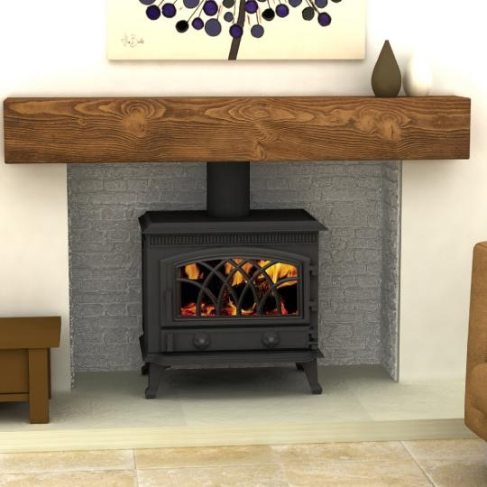 Woodburner. I love how this is recessed into wall to make it look like a fire place.