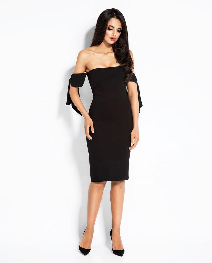 Matched dress made of knit fabric with decorative binding on shoulders. Dopasowana sukienka wykonana z opinającej dzianiny z ozdobnym wiązaniem na ramionach.
