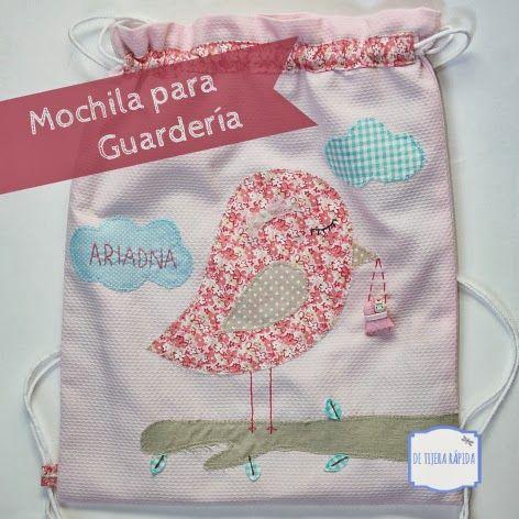 Mochila para guarderia en tonos rosas con un pajarito y el nombre bordado a mano.