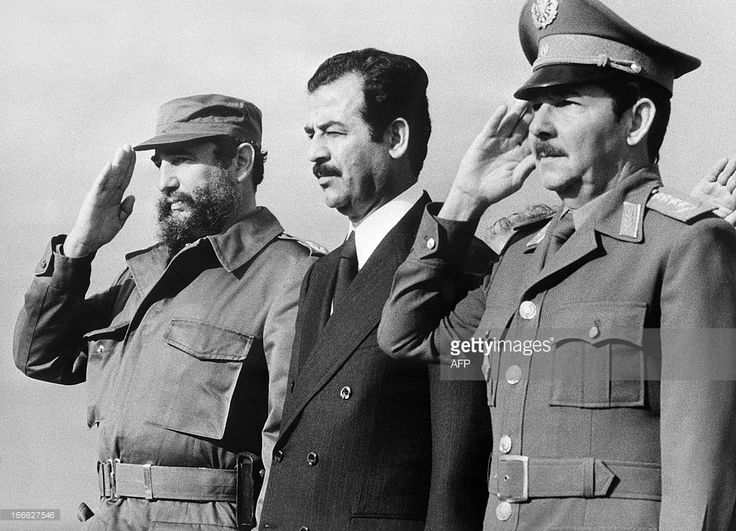 Iraqi vice-president Saddam Hussein (C), stands with Cuban President Fidel Castro (L) and Defense minister General Raul Castro (R), 30 January 1979 in Havana, during his visit to Cuba.