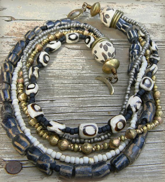 batik bone beads with old African sandcast beads, African handmade brass beads, and seed beads in neutral tones for a tribal statement neckl...