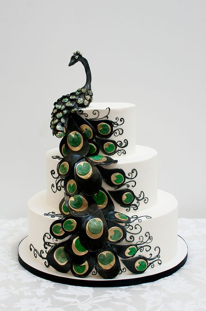 Another peacock cake. This one, almost seems like a winner. I would still want a brown base with cream and the cream/gold/teal/blue/purple peacock colors mixed in
