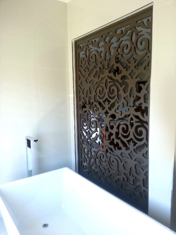 modern bathroom with a decorative screen qaq screens can add warmth to an otherwise - Decorative Screens