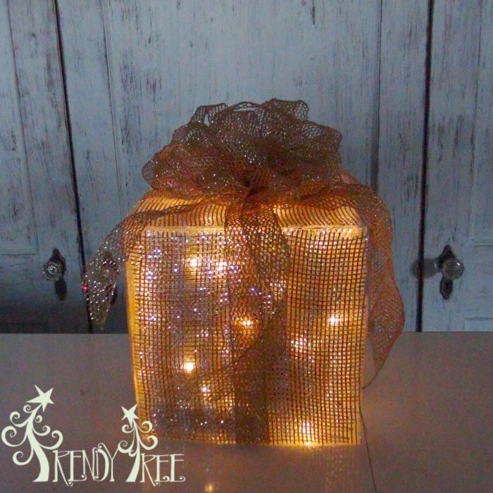 Lighted Christmas Present tutorial by Trendy Tree using plastic panels, wide foil deco poly mesh, ribbon, LED battery lights.