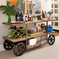 Loft  Get this casual loft look starting with a salvage-inspired cart balanced by fun accents like the bright wall art, contemporary wine rack, and bottle-glass vase. Top off with just a few accessories--gathering tray, beer glasses, nut and pretzel dishes, a party tub--and let the good times roll.