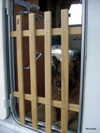 The K9 Gate in action, the solution to containing lively dogs on caravan holidays