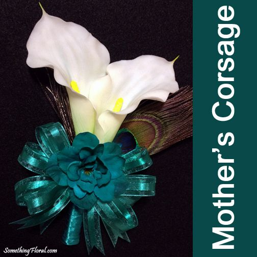 Realistic, artificial (no wilt!) calla lily, delphinium, and peacock feather corsage with teal ribbon. #corsage #calla #lily #callalily #delphinium #peacock #feather #peacockfeather #teal #wedding #prom #flowerstowear