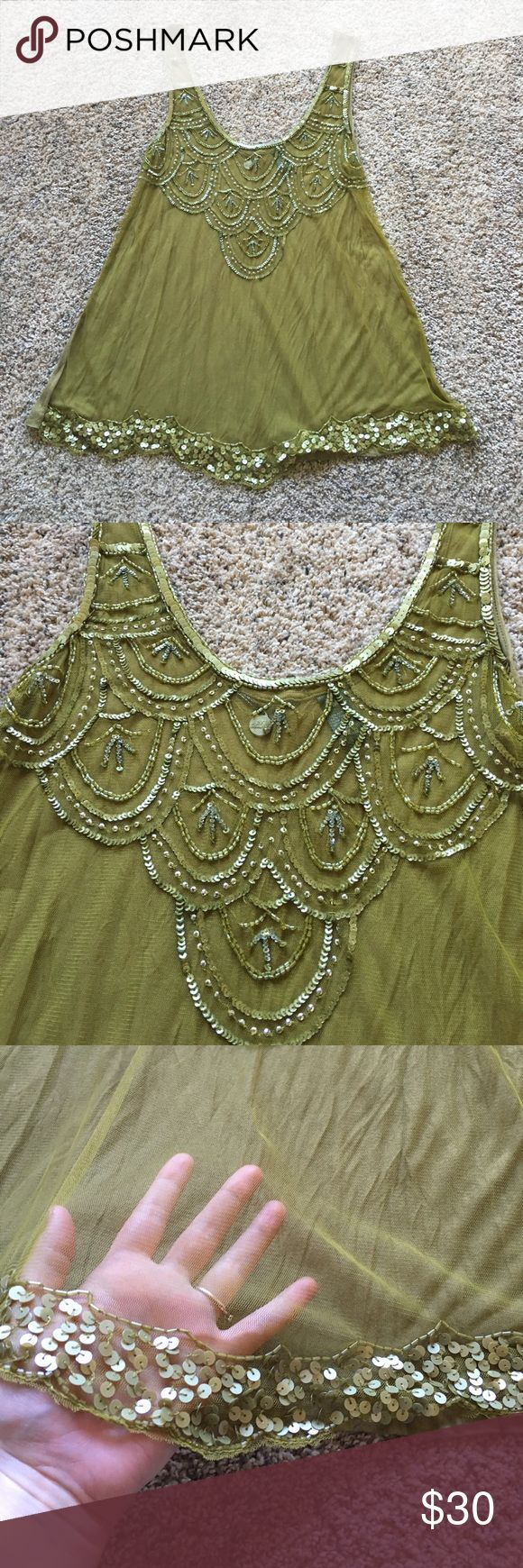 BKE Boutique Mesh Sequined Tank This top is so, so gorgeous. Front is mesh - while back is solid. Beautiful olive green color. Only flaw that I was able to find is pictures in most of the photos but more defined in the last, price reflected. Make me an offer! BKE Boutique Tops Tank Tops