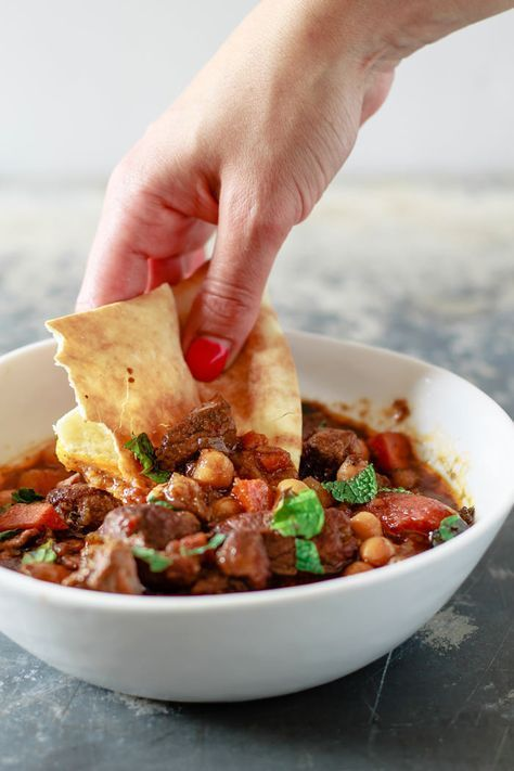 Moroccan Lamb Stew. Moroccan-spiced lamb, cooked to tender perfection w/ carrots, chickpeas and dried apricots. Braising & slow cooker instructions included!