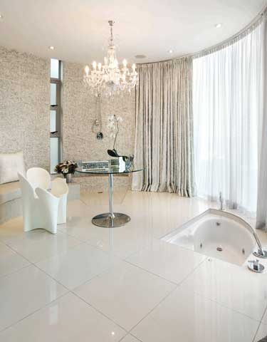 White #polished #porcelain, sunken bath and crystal #chandeliers - pure opulence. #UnionTiles