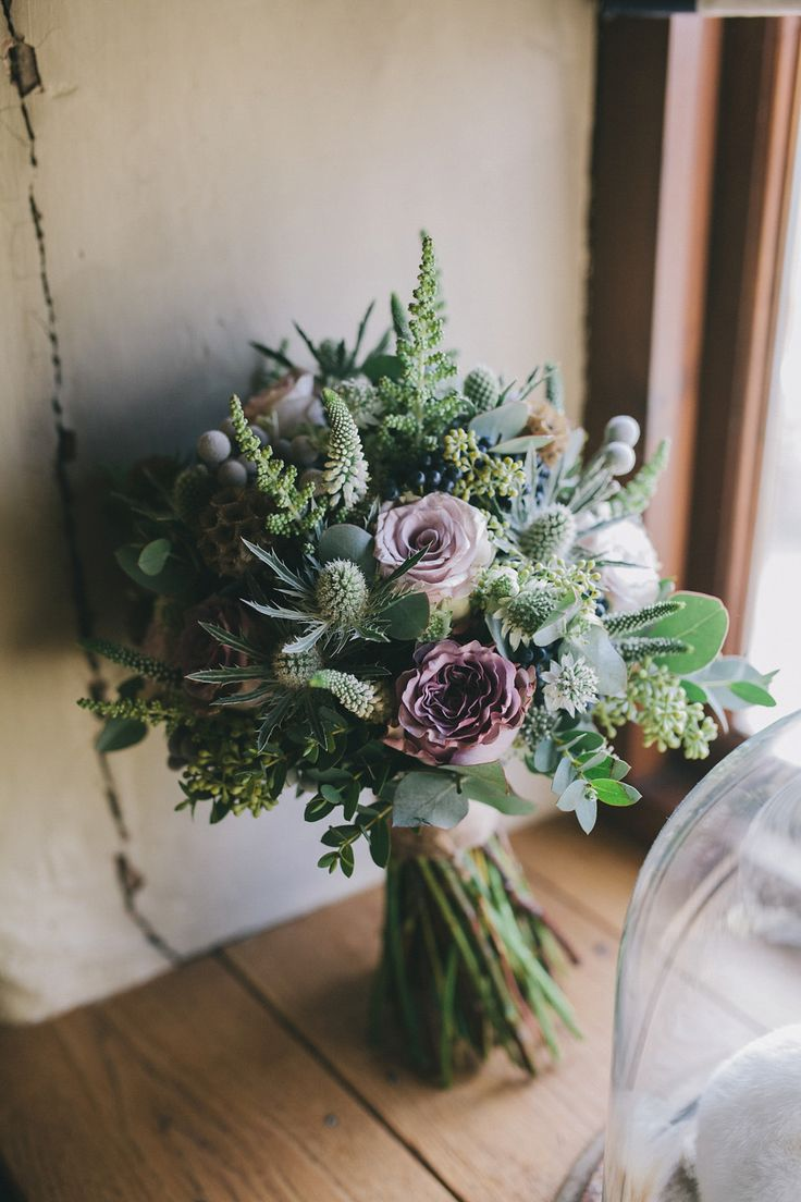 An elegant rustic Autumn wedding with a bride wearing flowers in her hair. Photography by Sally T.
