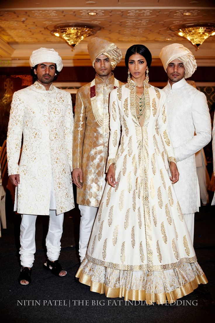 Indian white anarkalis and men's sherwanis by Rohit Bal for India Couture Week 2014