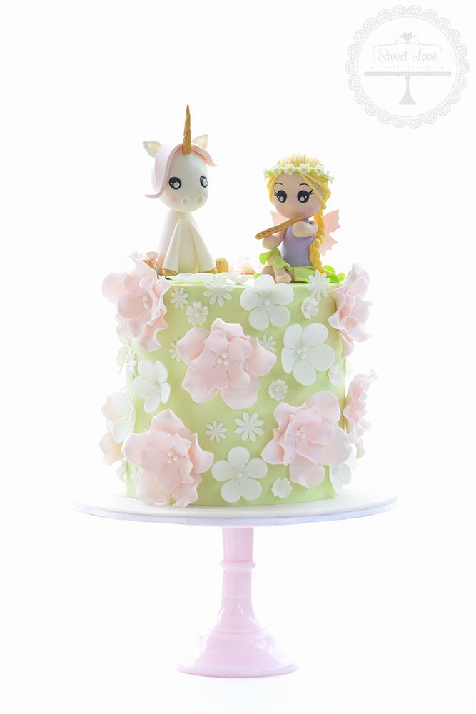 Gorgeous and girly birthday cake with sugar flowers. Unicorn and fairy figurines are handcrafted from sugar (based on creations by Arte da Ka)