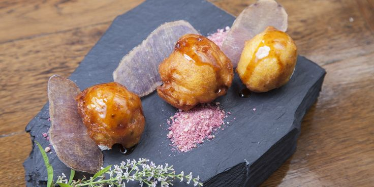 These tasty Peruvian sweet potato fritters go down a treat with the accompanying ricotta cheese and chancaca syrup