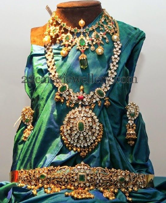 Large tear drops shaped motifs festooned short necklace with huge Zambian emeralds and square shaped small emeralds, round flat diamonds ...