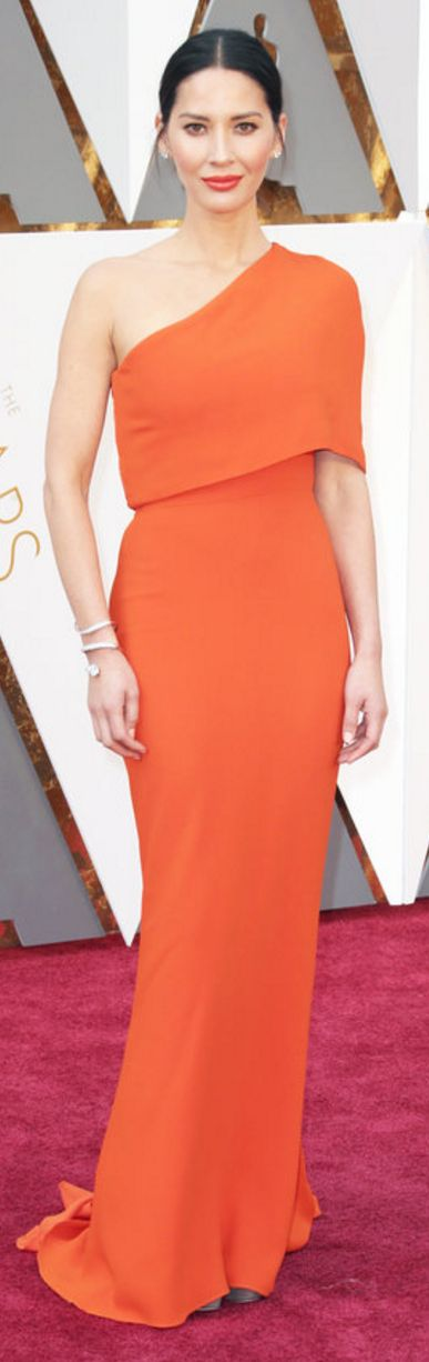 Who made Olivia Munn's orange one shoulder gown and jewelry?