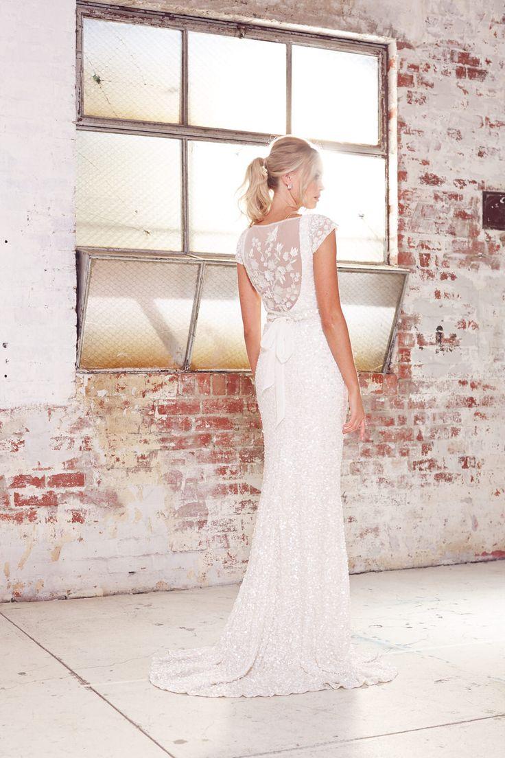 Detailed back of lace beaded wedding gown bridal from Karen Willis Holmes || Emma & Grace Bridal Studio || See more at emmaandgracebridal.co