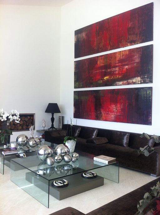 """canvases supply the """"wow"""" - black sofa & clear coffee table allow the art to be the focus"""