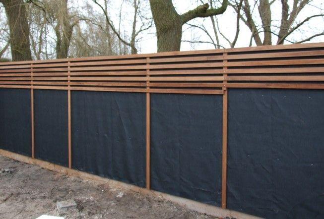 Zaun aus Platoholz und Wurzelstoff