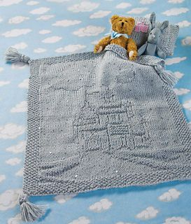 A sparkly blanket and matching pillow depict every little girl's fantasy: a castle to call her own.
