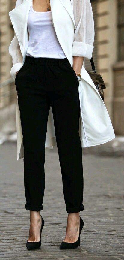 Black slacks and white tank top with coat/jacket