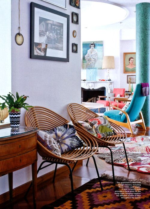 Love this eclectic home full of vintage treasures. Amazing chairs and rug.