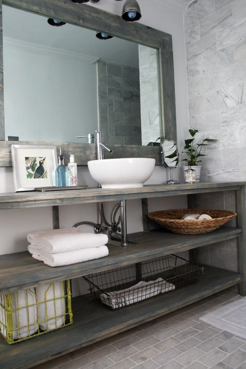 I love this simple open vanity shelving system with a small vessel sink. #vessel sink #design