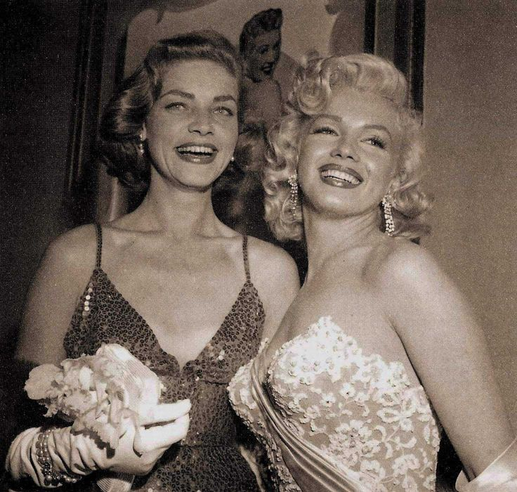 Marilyn Monroe and Lauren Bacall at the premier of 'How To Marry A Millionaire' 1953