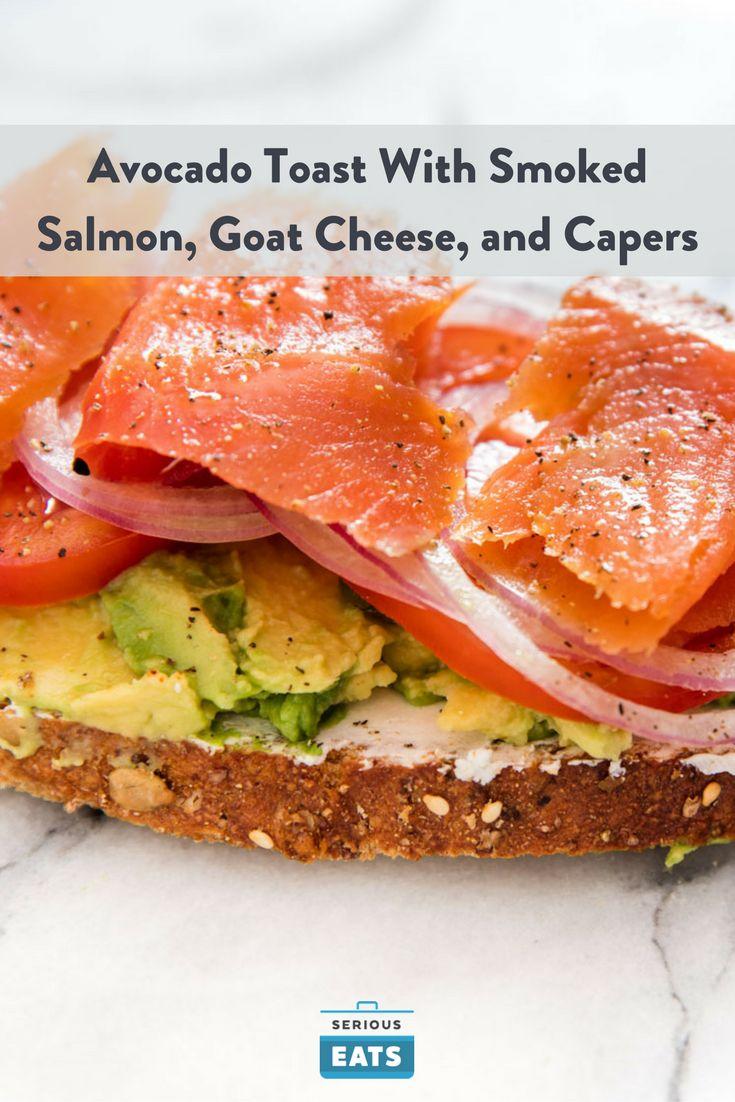 This bagel-and-lox-inspired open-faced sandwich combines avocado and smoked salmon, cut through with tomatoes, capers, and thinly sliced rounds of red onion.