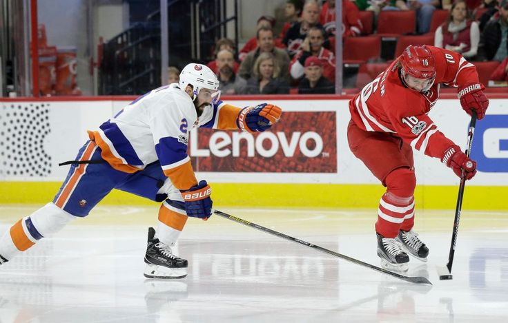 Carolina Hurricanes' Elias Lindholm (16), of Sweden, shoots as New York Islanders' Nick Leddy (2) defends during the second period of an NHL hockey game in Raleigh, N.C., Tuesday, March 14, 2017. Lindholm scored on the play.