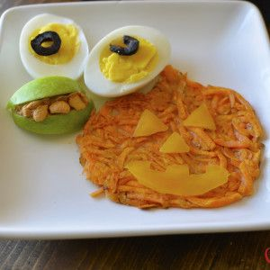 Have a Happy Halloween Breakfast with Halloween hash browns, a hard boiled egg and fruit!