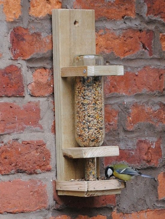 Wine Bottle Bird Feeder DIY here.. Looks fairly easy and can be prettied up