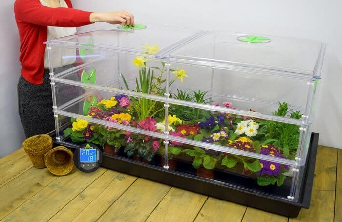 http://www.greenhousesensation.co.uk/media/catalog/product/optimized/0/d/0df606c923f0993ff67cbbcd479704a5/100w_deluxe_triple_height_vitopod_heated_propagator_4__3.jpg