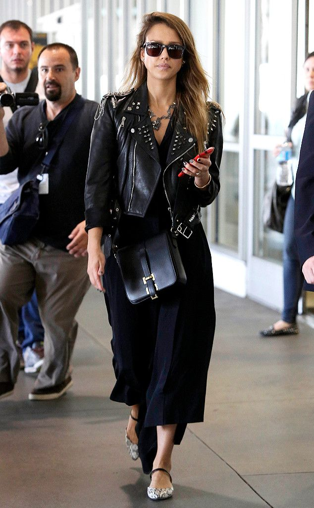 Dayum! Jessica Alba strutted her rocker stuff through LAX, sporting a studded leather jacket and chic shades!