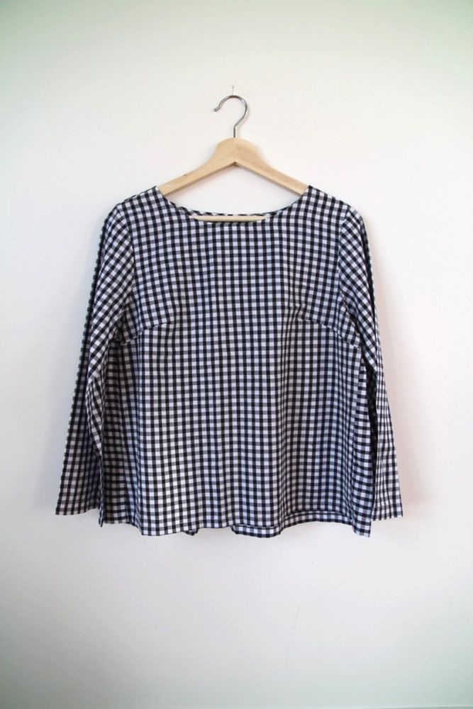 An all season soft cotton top in black and white gingham. Featuring a gently gathered back and long sleeves. This top is a loose fit allowing extra...