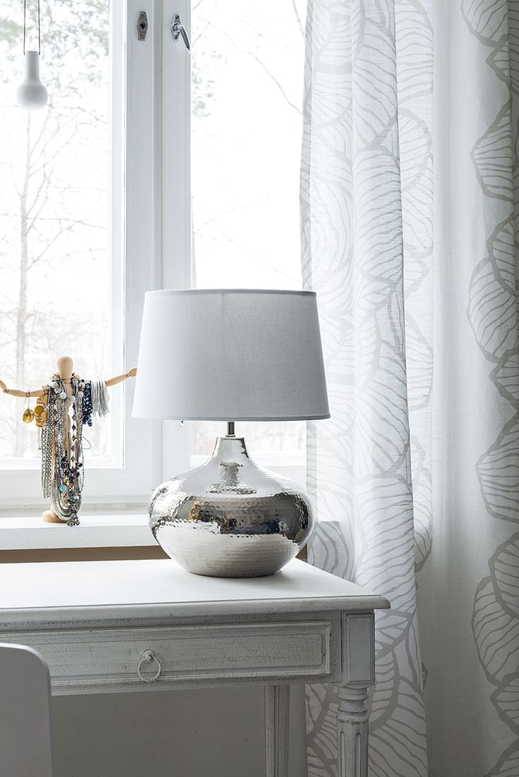 Corinne Lampstand | Corinne lampstand is made of silver-coloured brass.