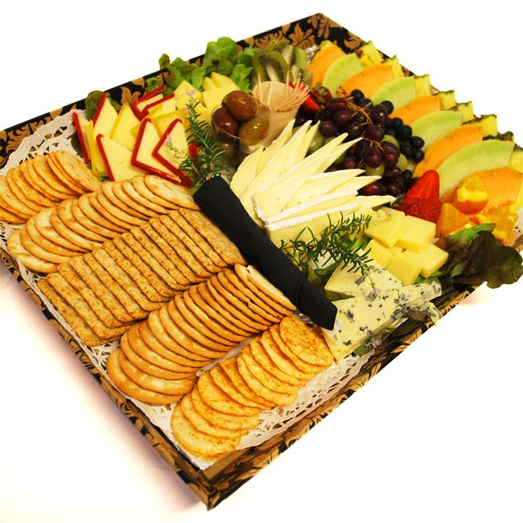 Eden Catering | Fruit & Cheese Platter assembled on a disposable board so that they can be distributed without needing to be returned.